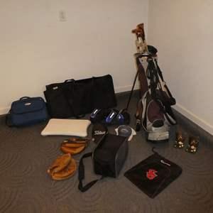 Lot # 99 - Assorted Golf Clubs, Golf Club Carrier, Catchers Mitts, Wii Balance Board, Sleeping Bag & Folding Poker Table