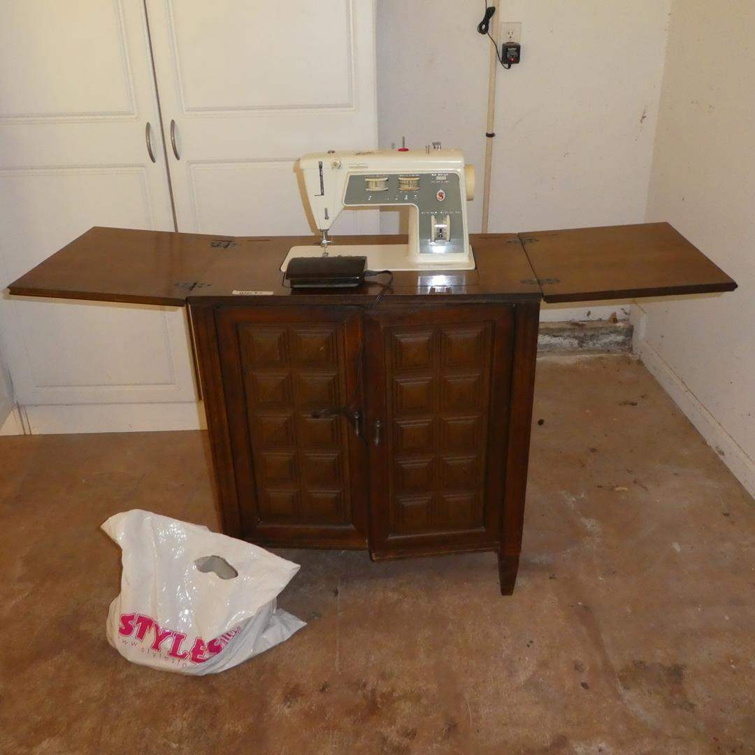 Lot # 106 - Vintage Singer Sewing Machine in Cabinet & Sewing Notions (main image)