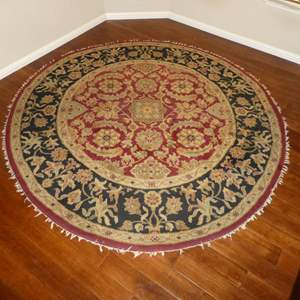 Lot # 14 -  96 in Diameter Wool Area Rug (Missing Parts of Outer Tassels/ Fringe)