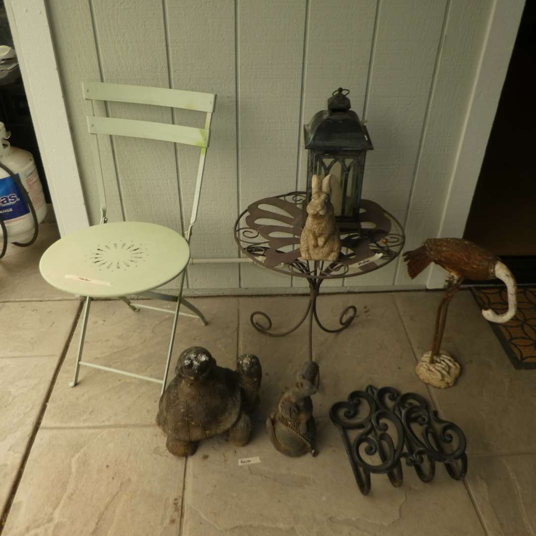 Lot # 34 - Metal Outdoor Bistro Table, Vintage Style Folding Chair & A Variety of Yard Art  (main image)
