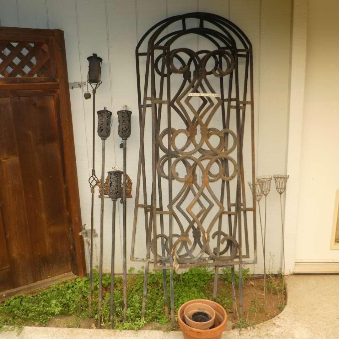 Lot # 39 - Three Metal Garden Trellises, Garden Torches and Misc Terracotta Pots   (main image)