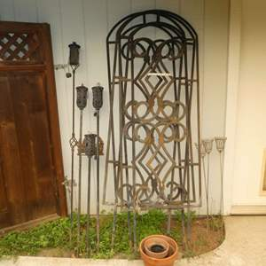 Lot # 39 - Three Metal Garden Trellises, Garden Torches and Misc Terracotta Pots