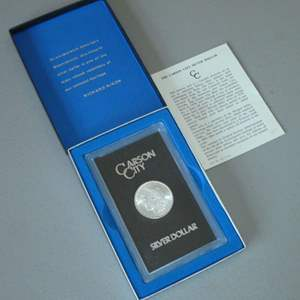 Lot # 5 -One (1) 1884-CC Morgan Silver Dollar - Carson City with Case