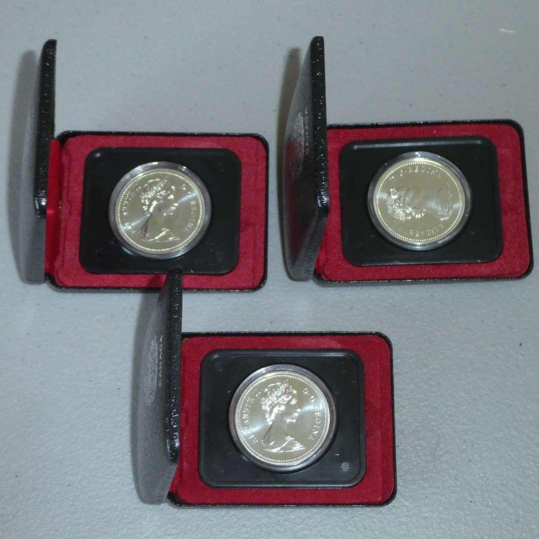 Lot # 10 - Three (3) 1975 Royal Canadian Silver Dollar Coin w/ Case (Calgary) (main image)