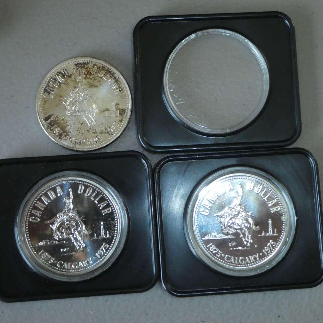 Lot # 18 - Three (3) 1975 Royal Canadian Silver Dollar Coin w/ Case (Calgary) (main image)