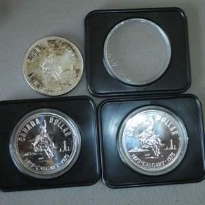 Lot # 18 - Three (3) 1975 Royal Canadian Silver Dollar Coin w/ Case (Calgary)