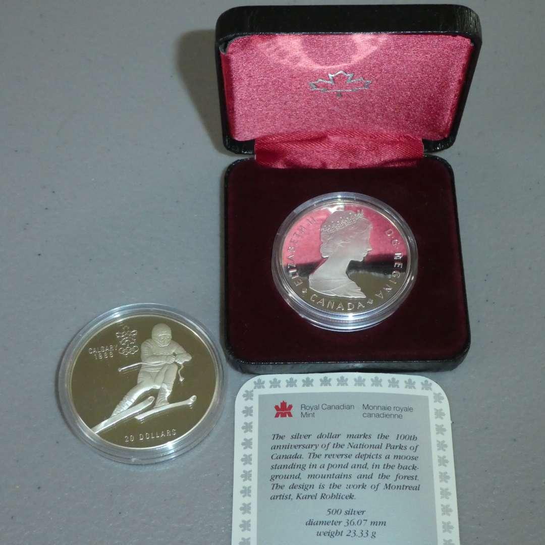 Lot # 30 -1985 Royal Canadian Mint Silver Dollar Coin, 1985 Royal Canadian Mint Silver 1988 Olympics Coin (See Full Description) (main image)