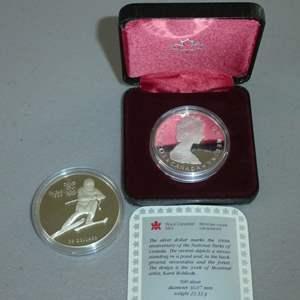 Lot # 30 -1985 Royal Canadian Mint Silver Dollar Coin, 1985 Royal Canadian Mint Silver 1988 Olympics Coin (See Full Description)