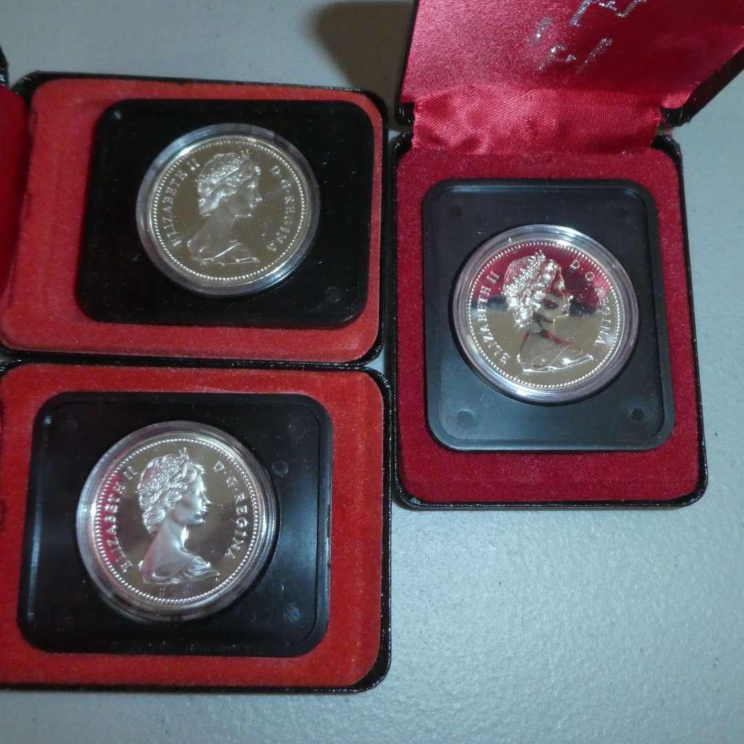 Lot # 67 - (2) 1974 Royal Canadian Mint -100yr Winnipeg Silver Dollar, 1976 Royal Canadian Min 100yr Library of Parliament (main image)