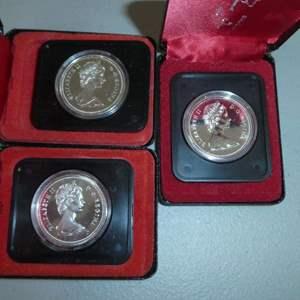 Lot # 67 - (2) 1974 Royal Canadian Mint -100yr Winnipeg Silver Dollar, 1976 Royal Canadian Min 100yr Library of Parliament