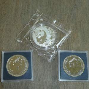 Lot # 116 -1982 - Canadian Silver Dollar (Texas),1981 - Canadian Silver Dollar,2001 - Silver Panda / Chinese Building