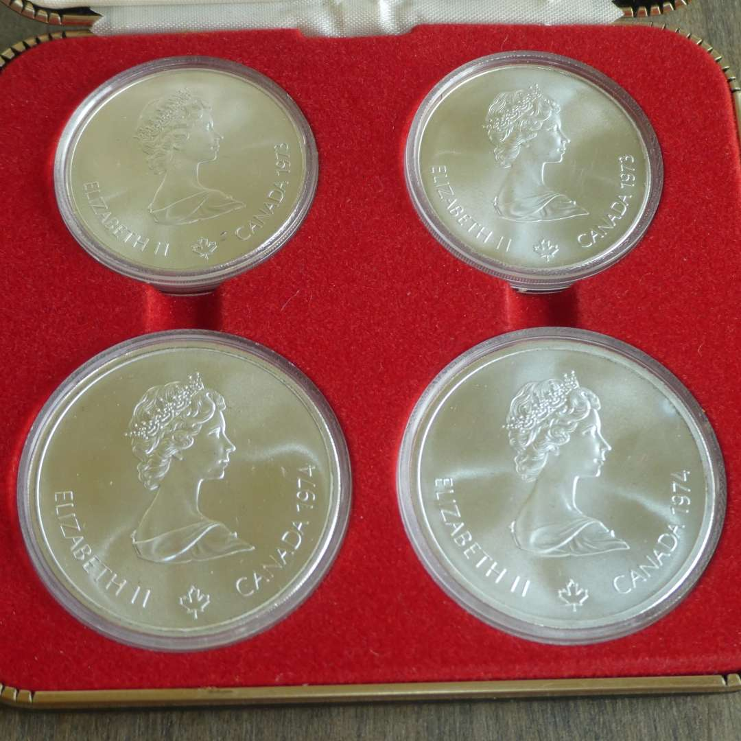 Lot # 121 -1973-74 - Royal Canadian Mint - 4 pc Olympic Silver Coin Set w/ Case (10d, 10d, 5d, 5d) (main image)