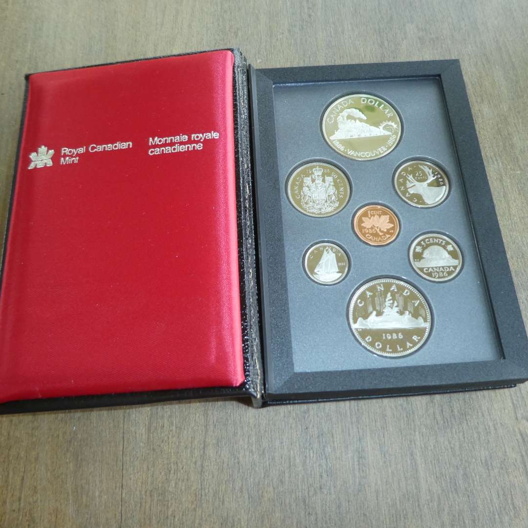 Lot # 126 - 1986 - Royal Canadian Mint - 7 pc Proof Set w/ Silver Dollar (main image)