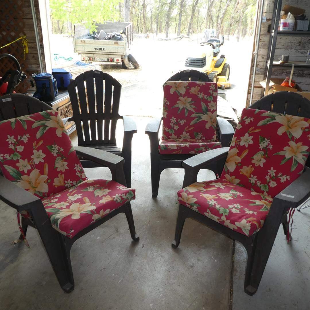 Lot # 64 - Four Plastic Patio Chairs - Three w/Cushions (main image)