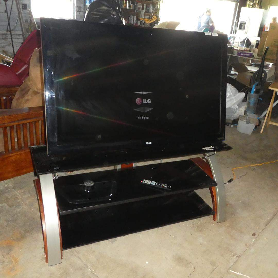 """Lot # 83 - LG 55"""" Flat Screen TV, Remote, Mount & TV Stand (main image)"""