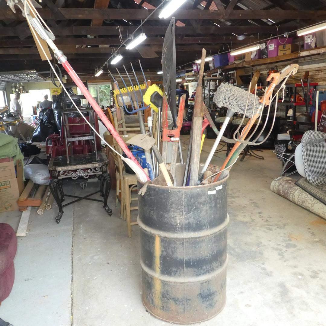 Lot # 85 - Metal Barrel Full of Misc. Yard Tools  (main image)