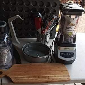 Lot # 19 - Kitchen Appliances Including A Ninja Blender, Bakeware And Utensils
