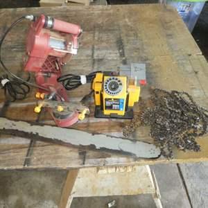 Lot # 182 - Drill Bit Sharpener, Chain Sharpener, Misc Chains & Chainsaw Bar