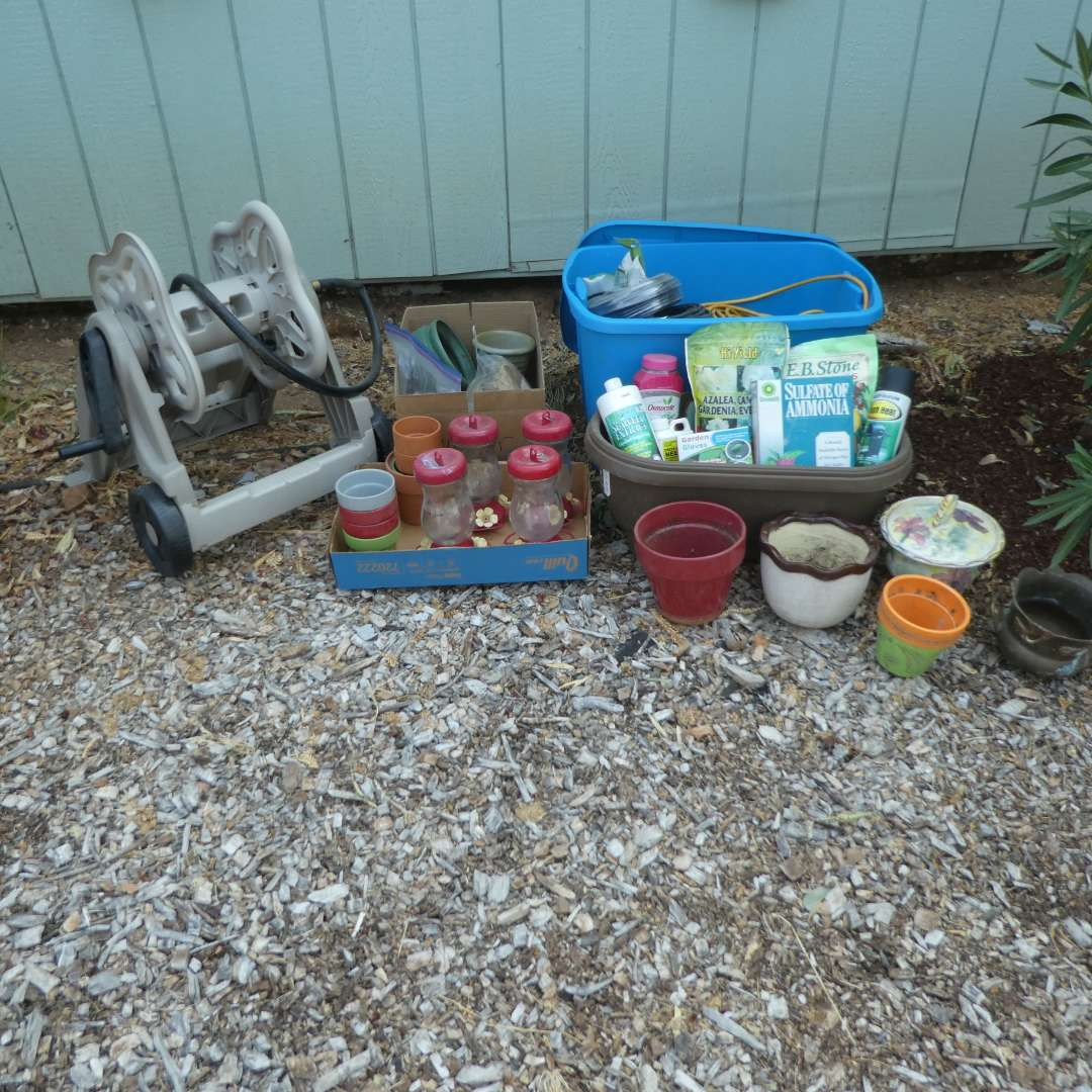 Lot # 156 - Garden Lot - Hose Reel, Hummingbird Feeders, Pots, Extension Cords  & Other Garden Supplies  (main image)