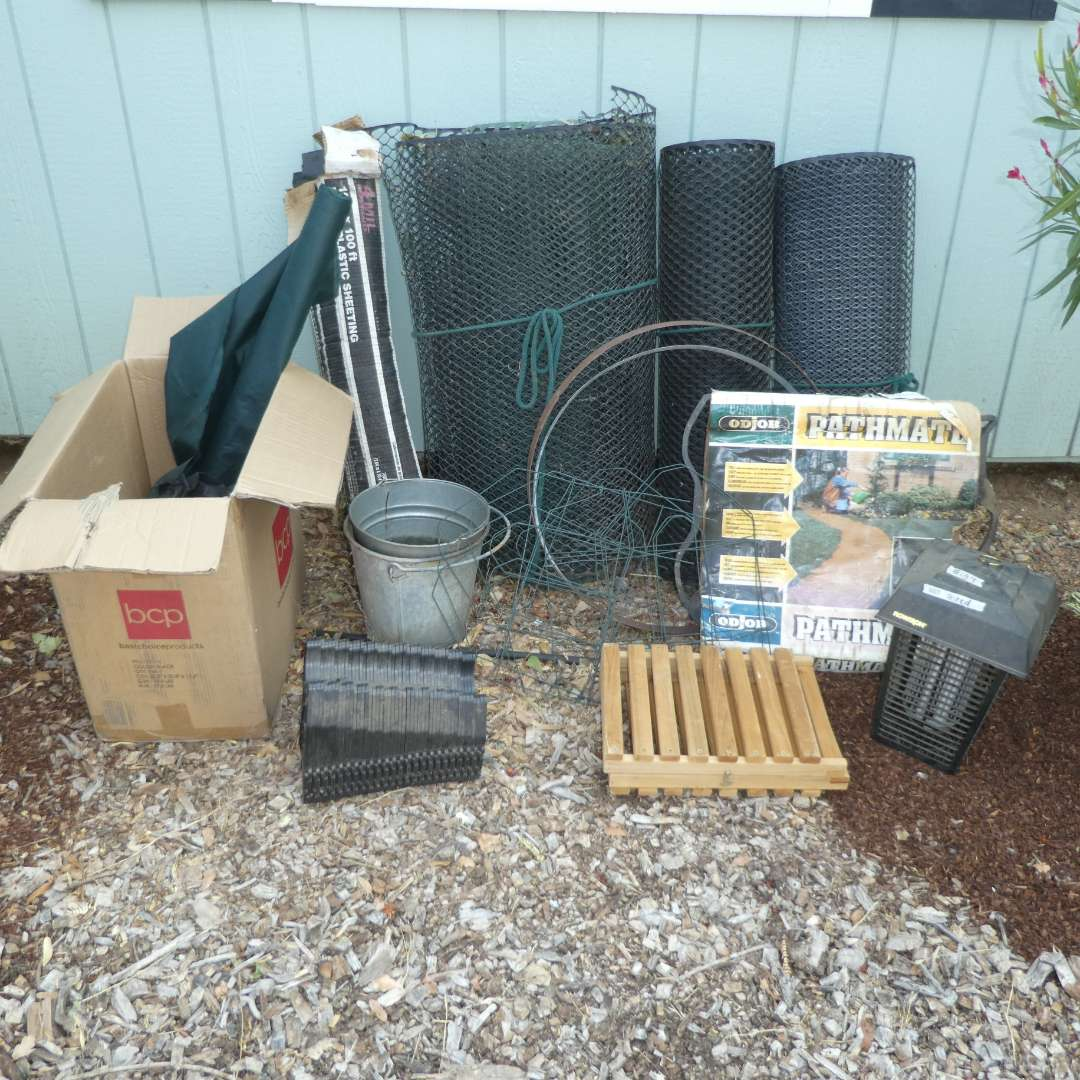 Lot # 159 - Misc. Garden Supplies - Landscape Fabric, Plastic Garden Fencing, Bug Zapper and More! (main image)