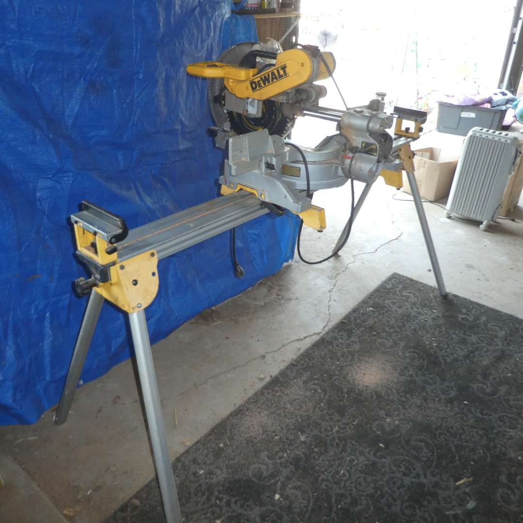 Lot # 165 - DeWalt (DW718) Miter Saw w/ Adjustable Stand  and Blades (main image)
