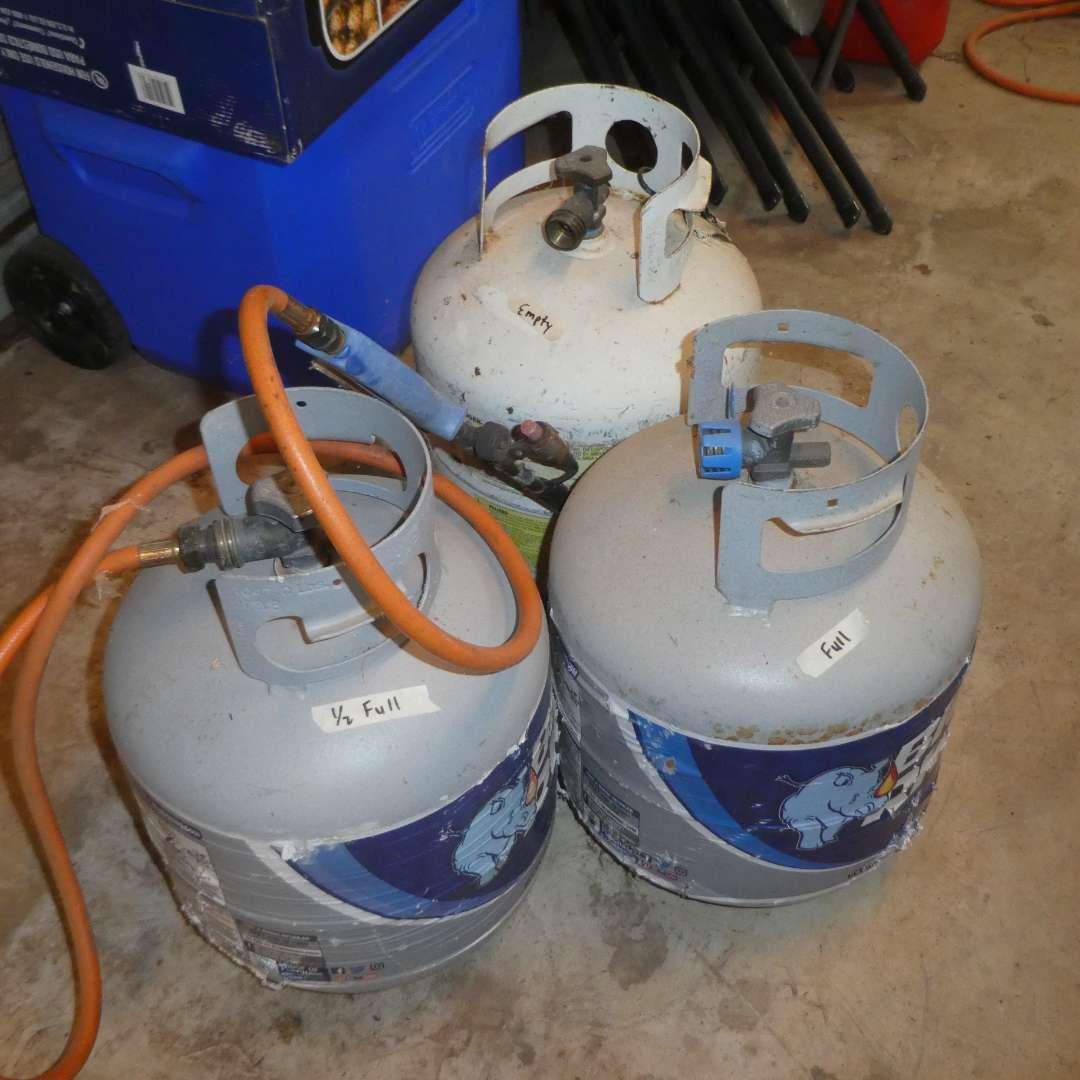 Lot # 166 - 3 Propane Tanks (Full, 1/2 Full & Empty) w/ Propane Torch (main image)