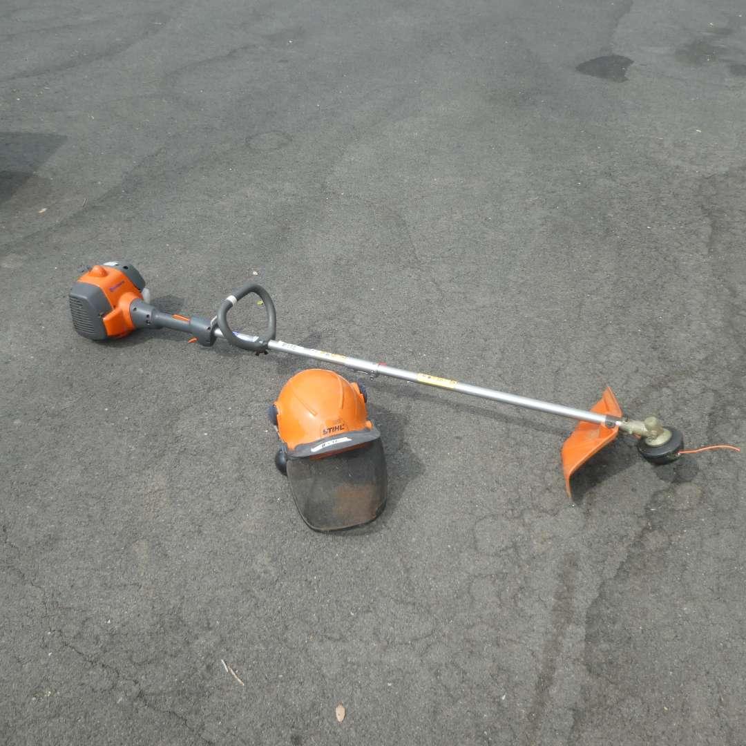Lot # 172 - Husqvarna (128LD) String Trimmer & Stihl Forestry Helmet  (main image)