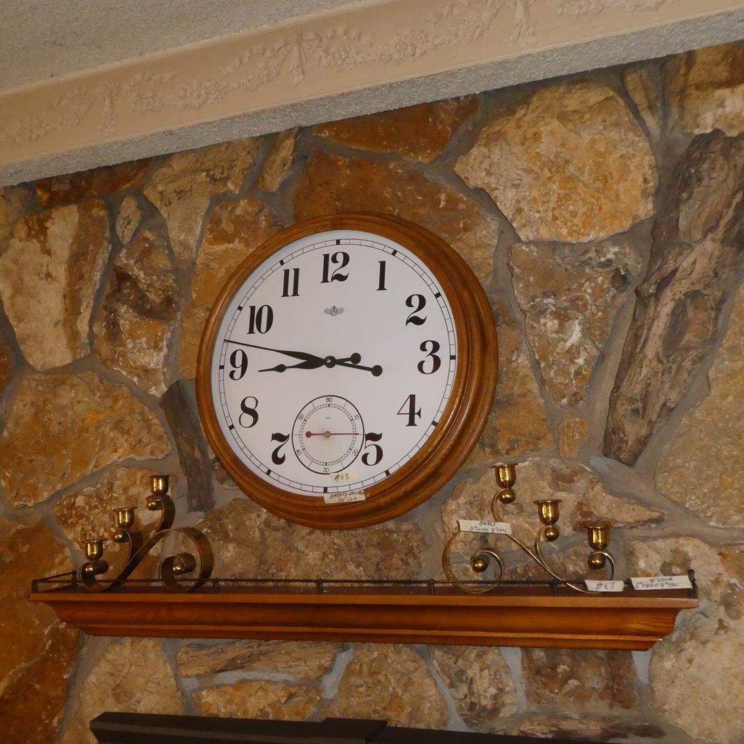 Lot # 63 - Large Round Quartz Wall Clock, Pair Brass Candle Holders & 4' Long Wooden Wall Shelf (main image)