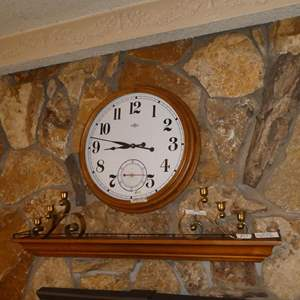 Lot # 63 - Large Round Quartz Wall Clock, Pair Brass Candle Holders & 4' Long Wooden Wall Shelf