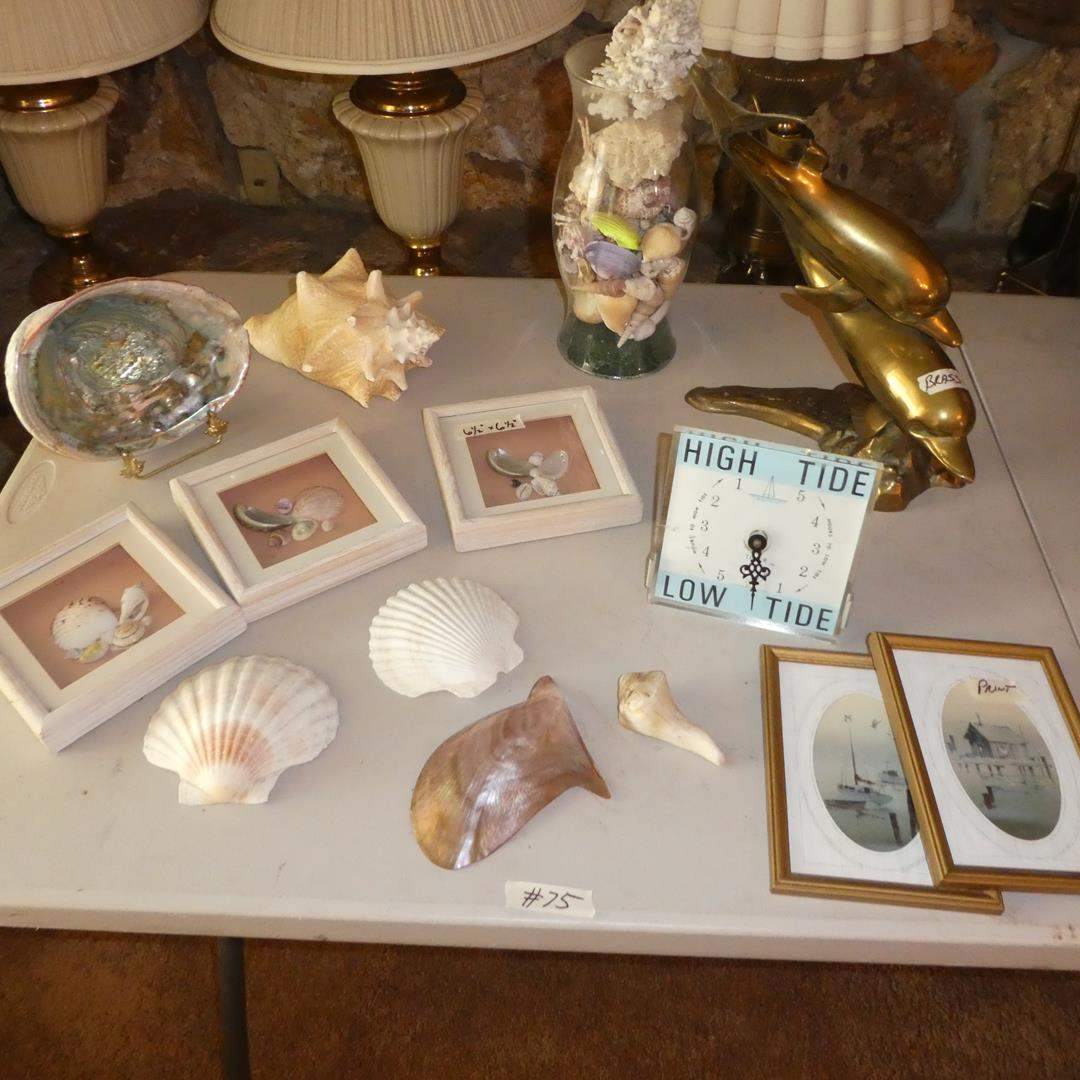 Lot # 75 - Seashells Collection, Small Nautical Prints, Tide Timer & Brass Dolphins Sculpture  (main image)