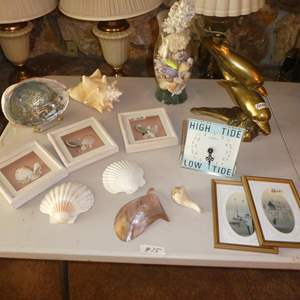 Lot # 75 - Seashells Collection, Small Nautical Prints, Tide Timer & Brass Dolphins Sculpture