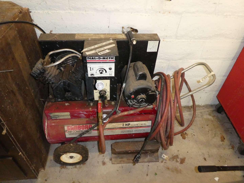 Lot # 265 - Sanborn Air Compressor (Runs, Has Small Leak) (main image)