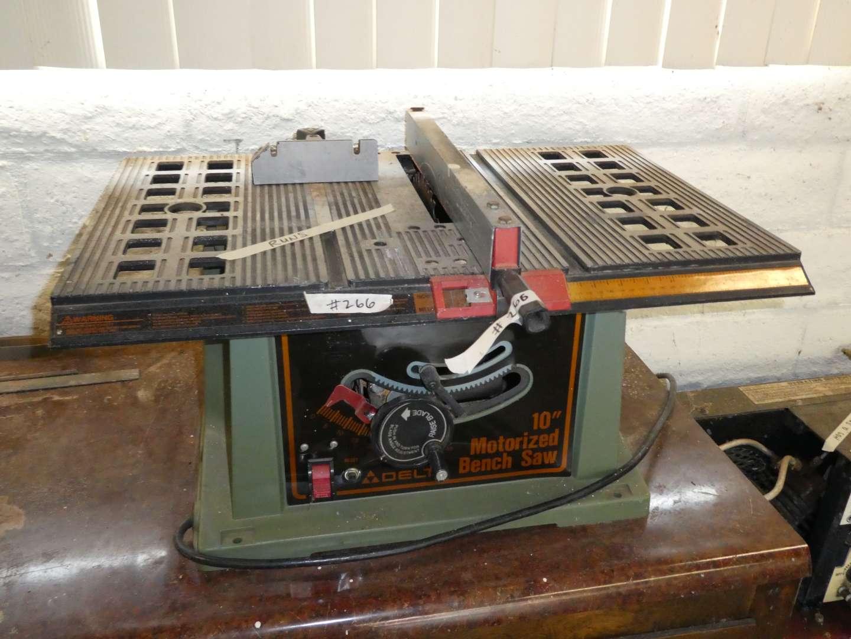 "Lot # 266 - Delta 10"" Motorized Bench Saw  (main image)"