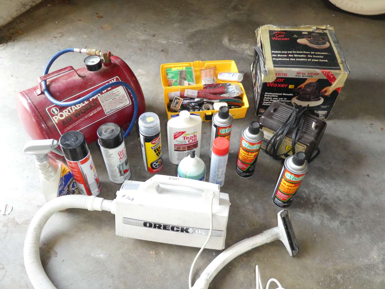 Lot # 268 - Oreck Vacuum, Portable Air Tank, Car Waxer & Misc Car Chemicals  (main image)