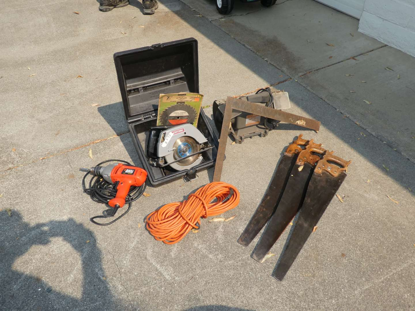Lot # 272 - Craftsman Bench Grinder & Skill Saw, Black & Decker Drill, Extension Cord & Assorted Hand Saws  (main image)