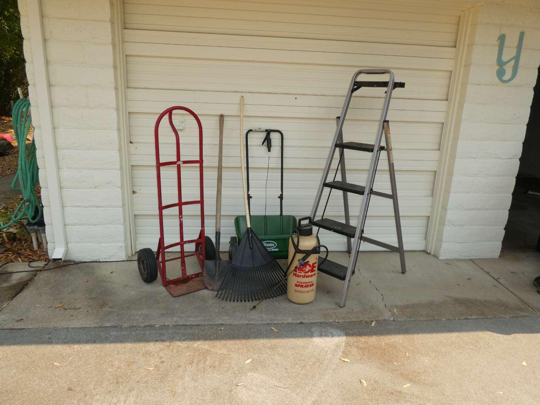 Lot # 273 - Folding Step Ladder, Hand Truck, Scotts Spreader, Sprayer, Rake & Shovel  (main image)
