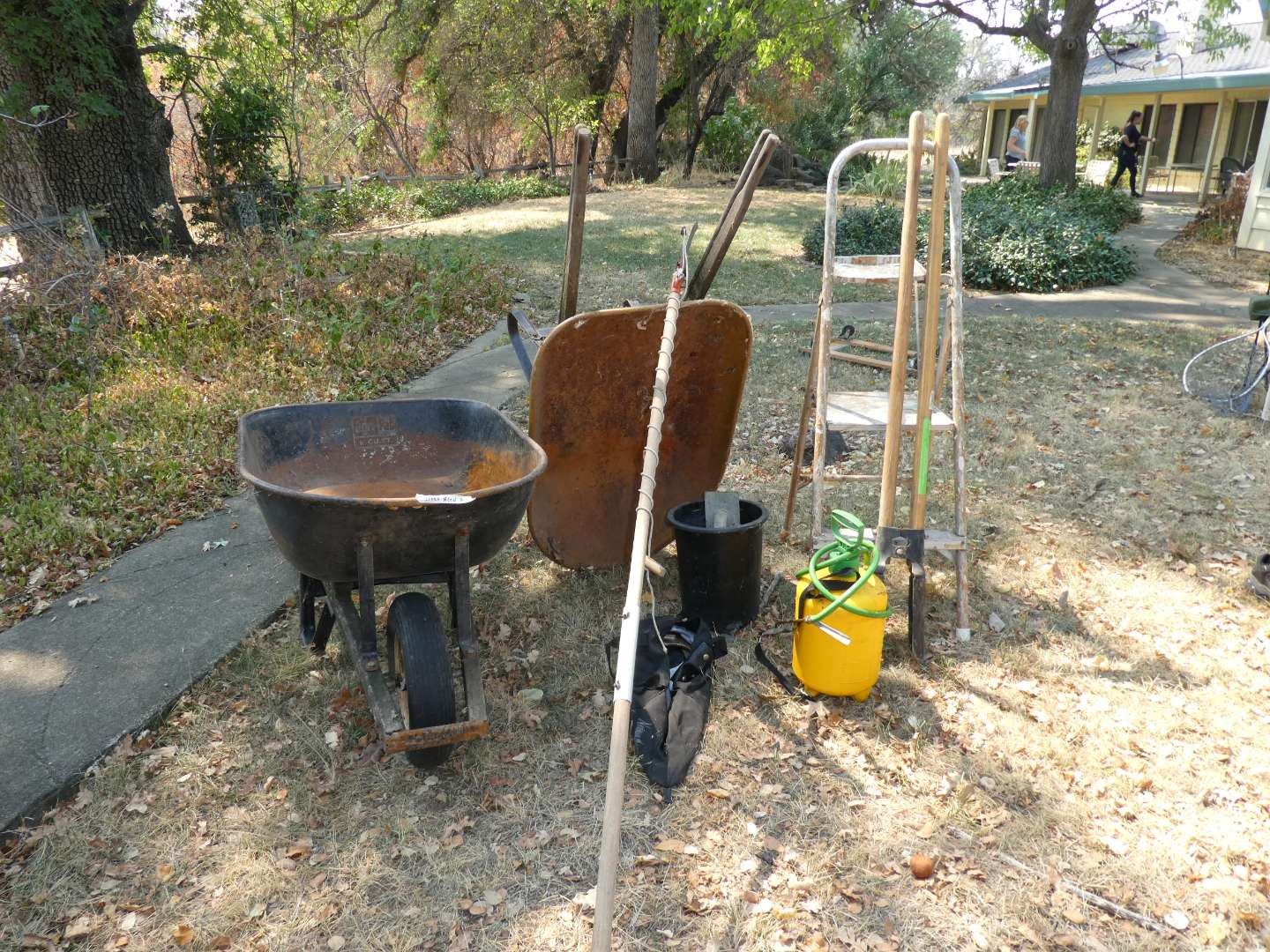 Lot # 277 - Wheelbarrows, Pole Saw, Post Hole Diggers, Step Ladder and Trowels  (main image)
