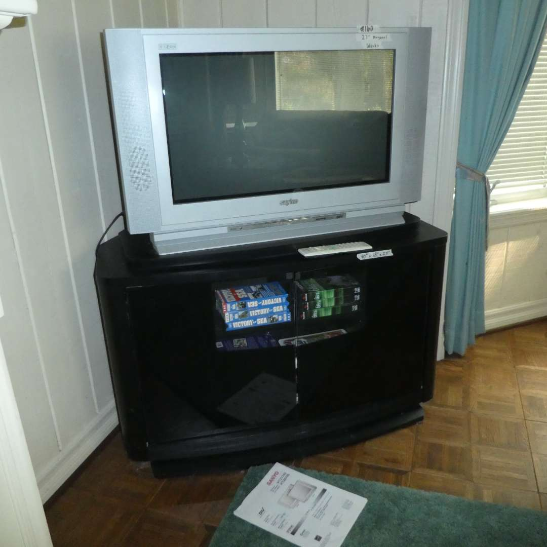 Lot # 160 - Sanyo TV, TV Stand w/ Swivel Top and Misc. VHS's (main image)