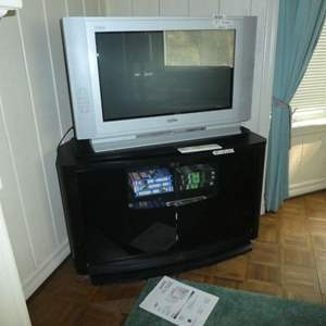 Lot # 160 - Sanyo TV, TV Stand w/ Swivel Top and Misc. VHS's