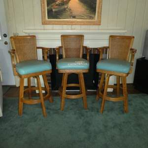 Lot # 166 - Three Vintage Bar Stools w/ Turquoise Color Seats & Cane Backing (Swivels)