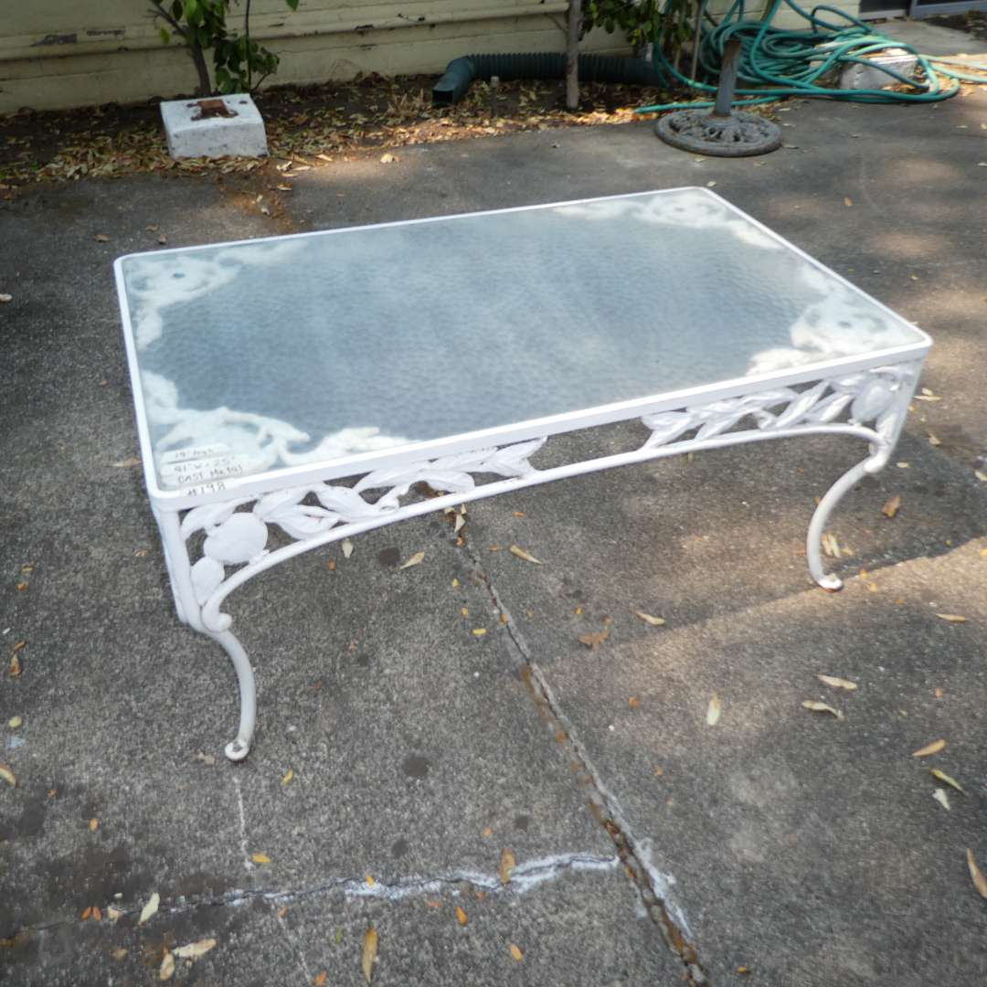 Lot # 198 -Vintage Woodard Pomegranate Pattern Wrought Iron Garden/Patio Coffee Table w/ Glass Top  (main image)