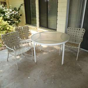 Lot # 202 - Outdoor Metal and Glass Table w/ 3 Cross Strap Chairs