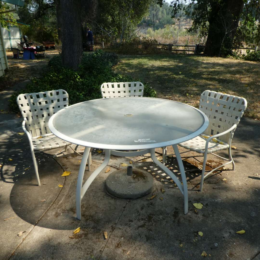 Lot # 203 - Outdoor Metal and Glass Table w/ 3 Cross Strap Chairs  (main image)