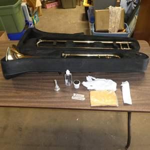 Lot # 241 - Mendini by Cecilio Trombone in Case & Chromatic Tuner Metronome