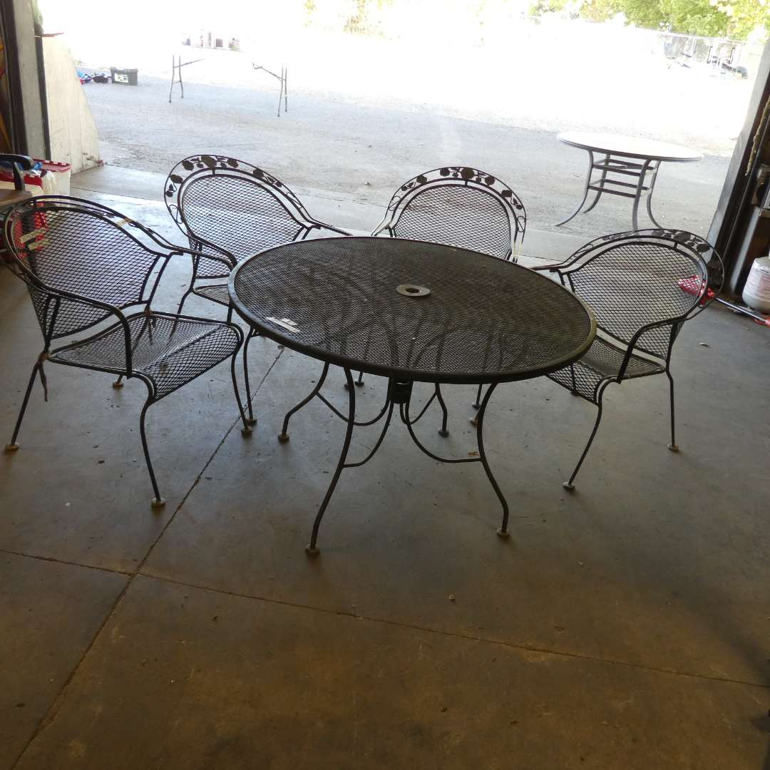 Lot # 6 - Round Metal Table With Four Chairs (main image)