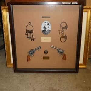 Lot # 165 - Shadow Box Wyatt Earp Award w/ skeleton keys, handcuffs, a badge, & replica revolvers