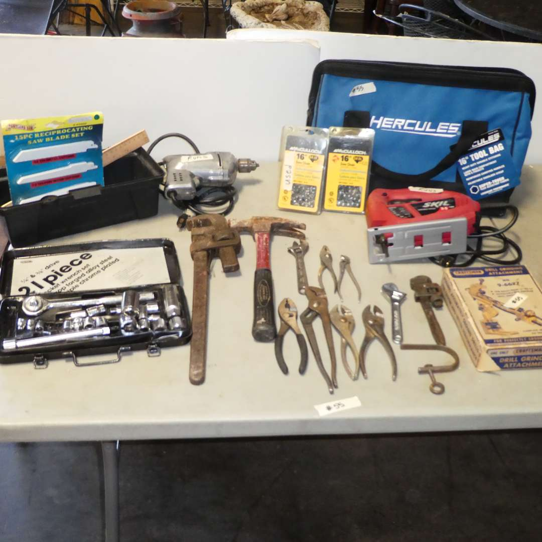 Lot # 55 - Tool Lot -Tool Bag, Wrenches, Socket Set, Skil Jig Saw, Chainsaw Chains, Craftsman Drill Grinding Attachments & More  (main image)