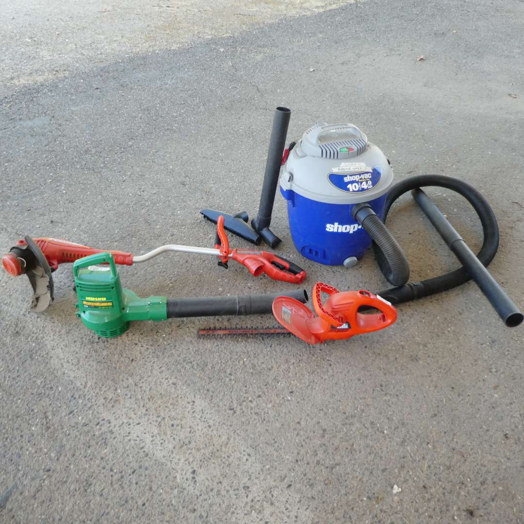 Lot # 64 - Electric Weed Eater, Blower, Head Trimmer & Shop Vac (Missing Wheels) (main image)