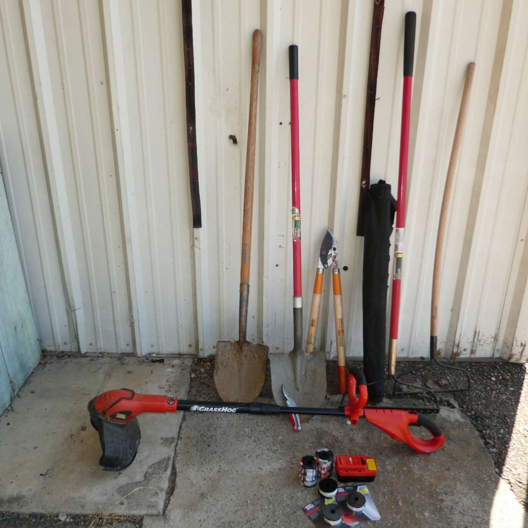 Lot # 65 - Yard Tools - Shovels, Rakes, Battery Operated Weed Eater, Weed Eater String  and Landscape Fabric (main image)