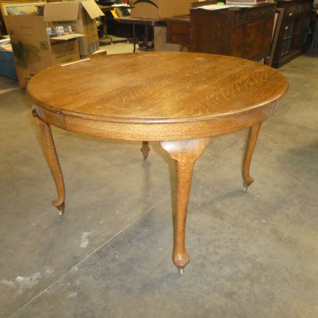 Lot # 84 - Round Vintage Solid Oak Dining Table on Wooden Casters  (main image)